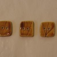 Boutons carrés ambres